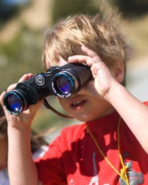 Little boy with binoculars. Photo by Jen Mailser